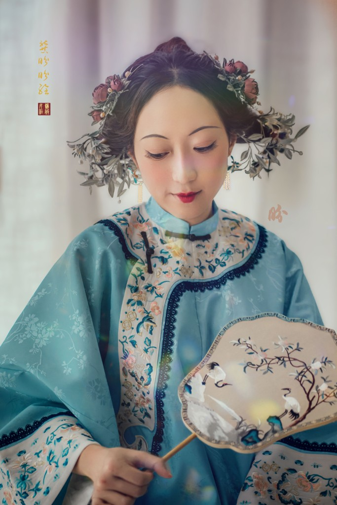 The Courtesan in this photo is entirely decked with silk wounded accessories (very Southern Chinese craft, Hakka in origin) which I commissioned a craftsperson to make based on the paintings. She was also wearing a mock Kingfisher feather earring with dangling pearls. Lace, although not usually seen in Chinese garment of this period, was already used in China in the 1900s.